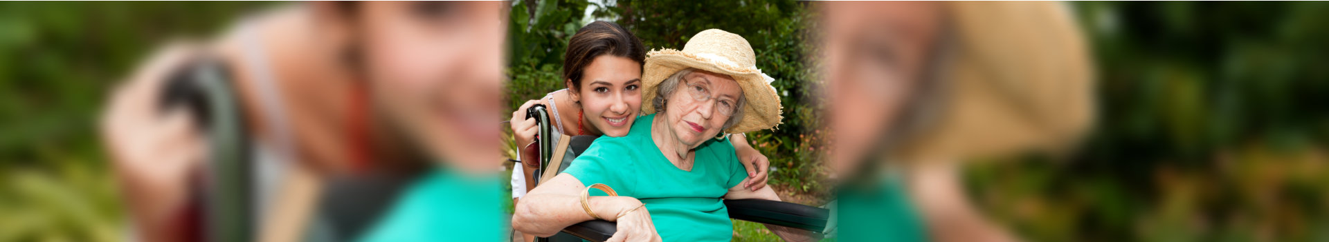 old woman on wheelchair and caregiver smiling