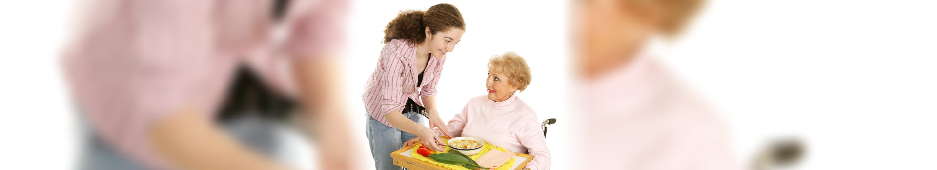 Caregiver preparing meal for the old woman